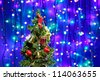 Decorated Christmas tree on multicolor bokeh background - stock photo