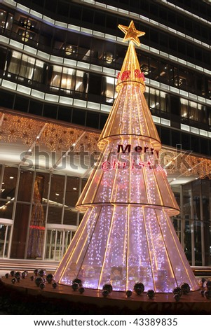 decorated  Christmas tree outside of a high building. Christmas theme - stock photo