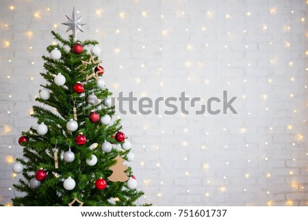 Decorated christmas tree over white brick stock photo 751601737 decorated christmas tree over white brick wall with shiny lights aloadofball Gallery