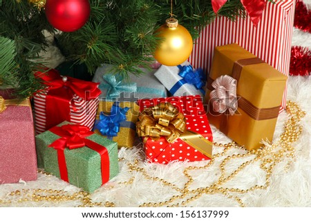 Decorated Christmas tree with gifts close-up - stock photo