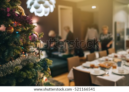Decorated Christmas tree with people in background