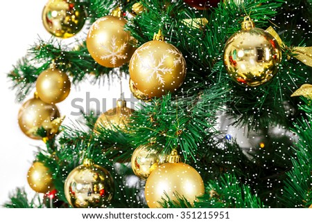 Decorated Christmas tree  with snow - stock photo