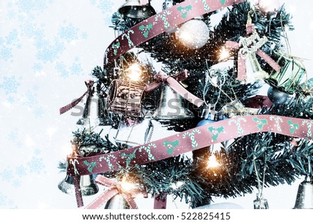 Decorated Christmas tree with snow abstract and light.