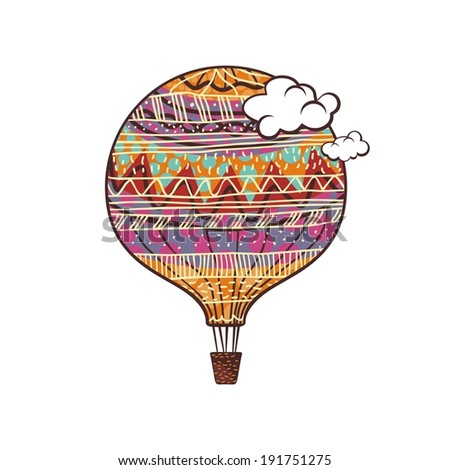 Decorated, colorful hot air balloon and clouds
