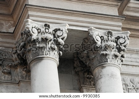Decorated columns of an old stone building