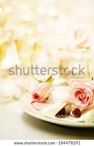 Decorated dinner table with beautiful pink roses - stock photo