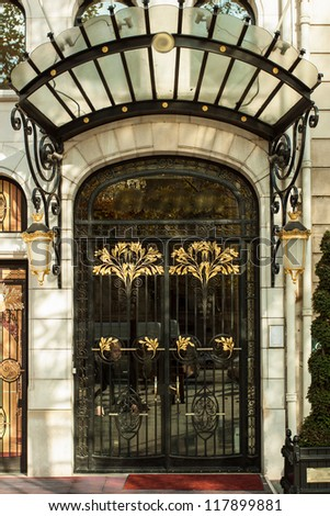 Decorated door of a luxurious hotel in paris - stock photo