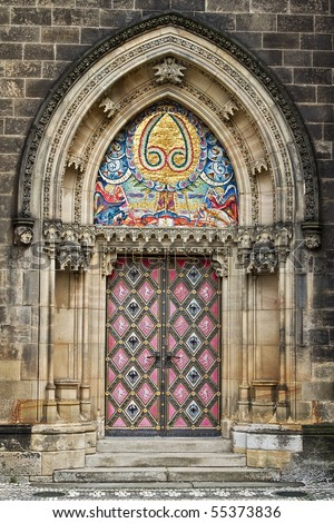 decorated door to the Gothic church - stock photo