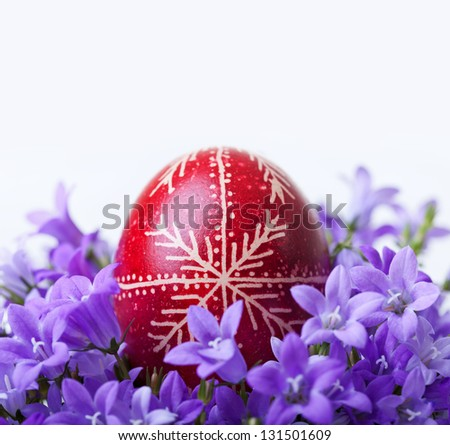 Decorated easter egg with spring flowers - closeup - stock photo