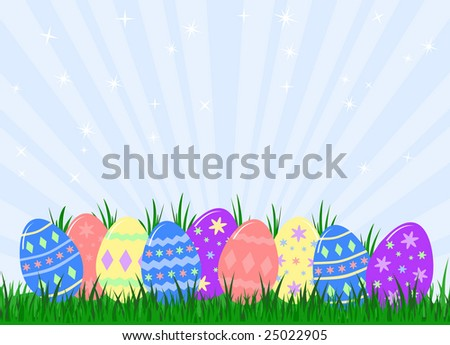 decorated easter eggs hidden in grass - stock photo