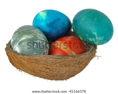 Decorated Easter eggs in a coconut