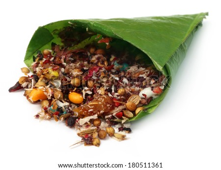 Decorated edible betel leaf for festivals over white background - stock photo