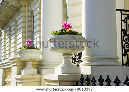 Decorated entrances of large houses in London's wealthy neighborhood Notting Hill. - stock photo