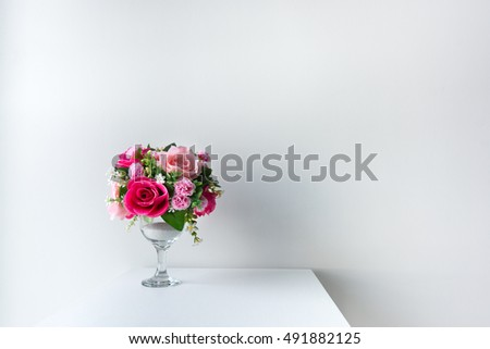 Decorated flowers on the white table
