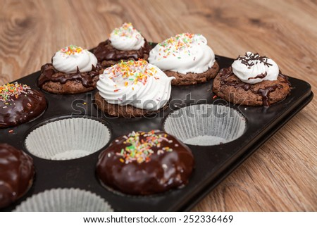 Decorated fresh muffins  - stock photo