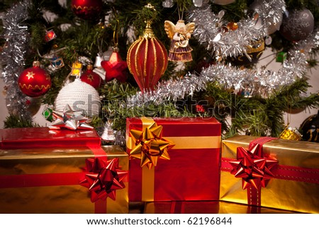 Decorated gift boxes under the Christmas tree - stock photo