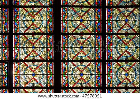 Decorated Glass Window in Notre Dame Church - stock photo