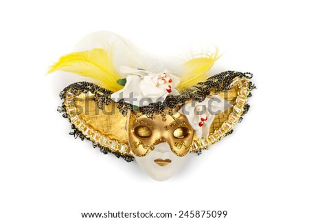 Decorated golden clay mask with hat isolated on white - stock photo