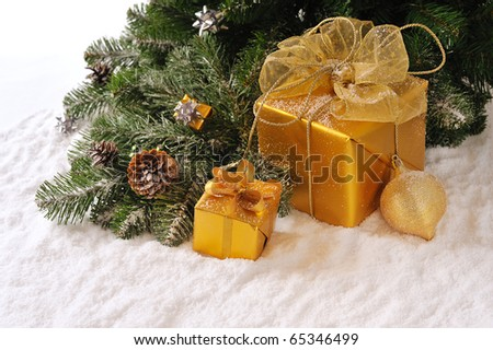 decorated golden gift boxes  under Christmas tree on white  background - stock photo