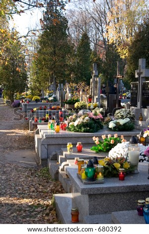Decorated graves in All Saints Day, Poland - stock photo