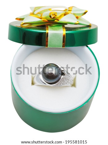 decorated green box with black pearl in white gold ring isolated on white background - stock photo