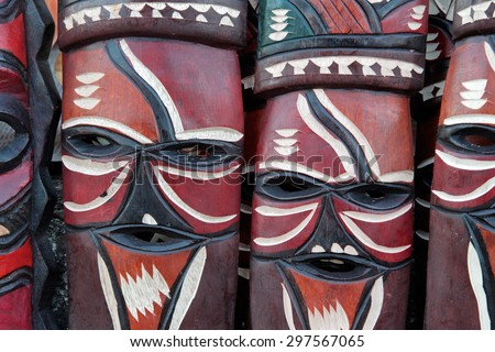 Decorated hand made wooden masks carved from the wood of African trees - stock photo