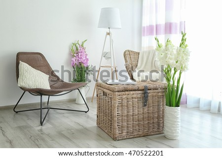 Decorated interior with bouquet of flowers in vase