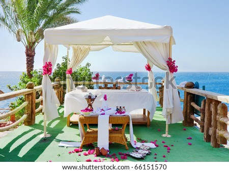 Decorated massage tent  on the seashore of luxury hotel - stock photo