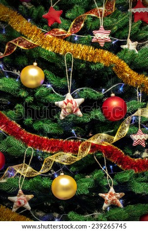 Decorated new year tree background with colored toys serpentine and garlands - stock photo