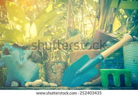 decorated outdoor gardening tools in garden with day noon light. - stock photo