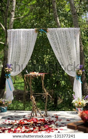 decorated place for wedding ceremony in forest - stock photo