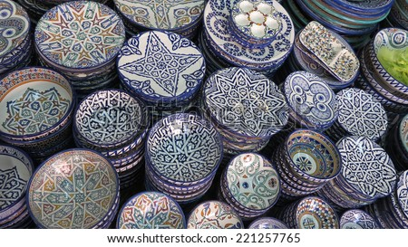 Decorated plates and traditional morocco souvenirs in medina souk - stock photo