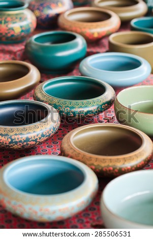 Decorated pottery on Panjiayuan Market, located in south east Beijing, China - stock photo