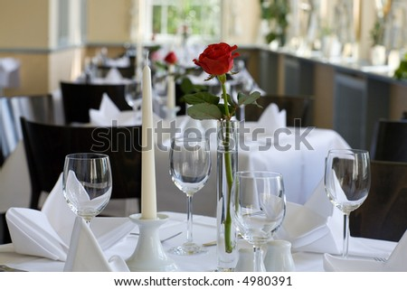 Decorated/prepared desk in empty restaurant. Friendly light. Landscape