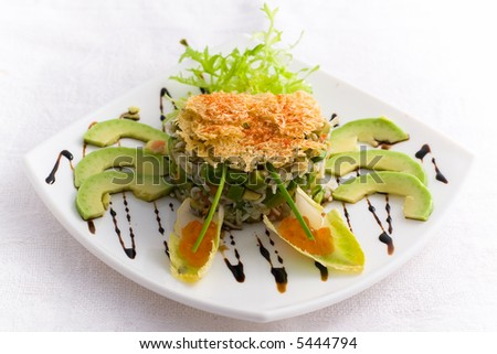 Decorated salad with crab meat - stock photo
