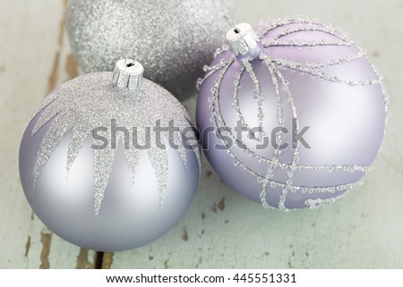 Decorated silver Christmas baubles with focus to a single bauble in the foreground to celebrate Xmas and the festive holiday season - stock photo