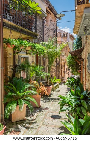 Decorated street in small town in Italy, Umbria - stock photo
