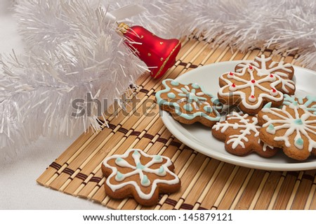 Decorated Sugar Cookies for Santa at Christmas Time on a table with decoration - stock photo