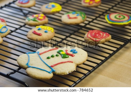 Decorated Sugar Cookies on Cooling Rack - stock photo
