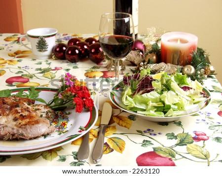decorated table for christmas dinner whit pork steak dish - stock photo