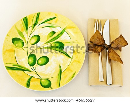 decorated table serving with serviette and knife,fork at beige - stock photo