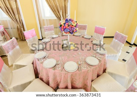 Decorated table with beautiful flowers in the elegant restaurant for the perfect wedding - stock photo