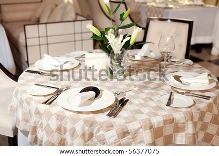 decorated table with bouquet of white lily