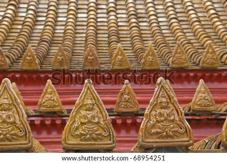 Decorated Tiles on the roof of a Thai Wat - stock photo