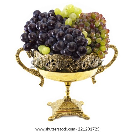 Decorated vase with green, red and blue grape isolated - stock photo