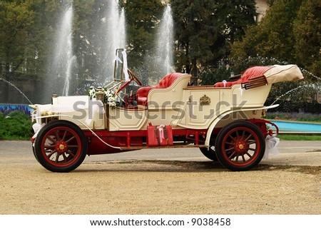Decorated vintage dream wedding car - stock photo