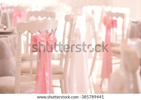 decorated wedding chairs - stock photo