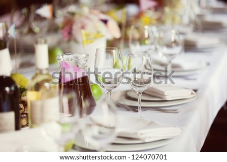 decorated wedding table in the restaurant - stock photo