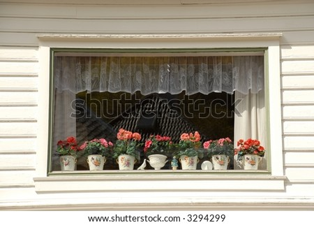 Decorated window in white wooden house - the charm of Bergen, Norway
