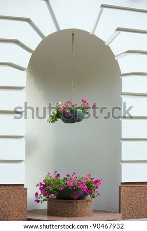 Decorated with flowers the building niche, outside. - stock photo